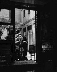 stories of the sidewalk (AndreaFernandez) Tags: life street family light white black monochrome by bar walking mom outside photography restaurant kid child walk captured mother strangers son stranger lives inside moment
