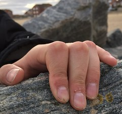 Mucky boy paw. (mornarees) Tags: gripping fingers sea rocks iphone6 portrait hand