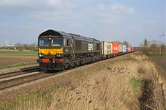 66779 March (Gridboy56) Tags: gm gbrf railways railroad railfreight trains train locomotives locomotive england europe emd march cambridgeshire uk felixstowe birchcoppice birmingham 66779 eveningstar 4m29 windmill windmills