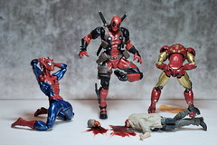 Did I Step in Something? (Pete Tapang) Tags: spiderman spider man ironman iron tony starks peter parker comics kaiyodo amazing yamaguchi revoltech toy action figure super hero wade wilson deadpool