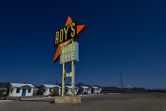 roy's motel on route 66. amboy, ca. 2013. (eyetwist) Tags: eyetwistkevinballuff eyetwist night amboy route66 california desert mojavedesert nikon d7000 nikkor 1024mm 1024mmf3545g fullmoon longexposure startrails stars derelict dark moonlight moonlit abandoned motel roadsideamerica americana route 66 mother road moon weathered roadtrip vintage sign type typography typographic roys diner roysmotel roysdiner cabins arrow googie midcentury modern mcm cafe vacancy empty american west landmark famous