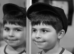 Enoa (nicolaspetit7878) Tags: flickr portrait f18 50mm nikond5500 nikon sourire reflet double miroir miror yeux regard casquette visage face enfant young children he noirblanc blackwhite garçon boy flickrfriday