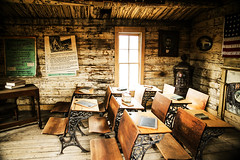 Inside The Coffin School (wyojones) Tags: wyoming cody codycity oldtrailtown bobedgar historicbuildings history preservation woodriver wbarranch shool meeteese building cabin desks classroom oneroomschoolhouse coffinschool alfrednower death light education