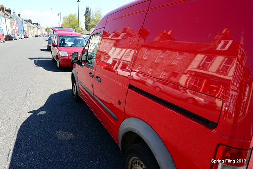 A red van reflects...