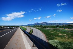 Roads, Rockies, Clouds and Colors (Let Ideas Compete) Tags: road sky green weather clouds spring highway colorado crossing may sunny boulder co flatirons springtime foothillsparkway concordians diagonalhighway