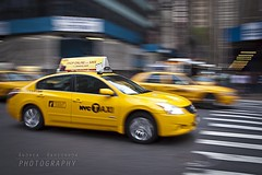 Speed (Andrea Rapisarda) Tags: street nyc urban speed taxi olympus panning velocità oly sfocato yellowcabs ©allrightsreserved e620