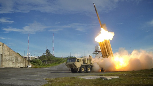 A THAAD missile system intercepts ballistic missiles during a test near the US in Sept 2013.
