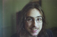 (Emily Savill) Tags: boy portrait man film smile face cheese analog hair beard gold glasses kodak 10 handsome iso 200 shaggy kr analogue asa dust expired ricoh kr10 expiredfilm