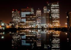 Canary Wharf (Amy Robinson1) Tags: london reflections nighttime canarywharf vision:text=0558 vision:sunset=0582 vision:dark=0763 vision:sky=0888 vision:outdoor=0718 vision:clouds=0667