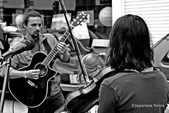 getting in tune (japanese forms) Tags: street autumn bw woman man youth blackwhite bokeh herfst streetphotography buskers fiddle agfa thewho vrouw jonge acousticguitar jongen vlaanderen zwartenwit straatfotografie agfafilm gettingintune strasenfotografie ©japaneseforms2013
