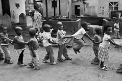 Kids on the playground (Tuk Tuk Tales) Tags: africa travel viaje school boy people urban bw playing girl playground kids children southafrica mono town blackwhite kid nikon village child candid streetlife monotone teacher elim limpopo kindergarden ribollaartsroute