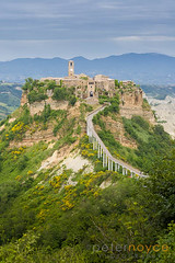 Civita di Bagnoregio Tuscany striking position atop a plateau of friable volcanic tuff overlooking the Tiber river valley (Peter Noyce) Tags: travel bridge italy travelling history italian europa europe village footbridge path hill neglected villages historic hills sidewalk tuscany historical traveling crumble toscana decrepit footpath tumbledown derelict span pathway decaying ramshackle dilapidated tatty crumbling rundown etruscan hilltown travelled traveled battered tuscan shabby poorcondition condition civitadibagnoregio threadbare uncaredfor hillvillage tourismleisure tuffrock