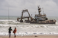 Cape Cross, Namibia - Men Fishing at Seal reserve .Cape Fur Seals (Remsberg Photos) Tags: ocean africa abandoned landscape fishing fisherman waves ship working relaxing reserve shipwreck seal blueskies namibia capecross catchingfish capefur skelotoncoast