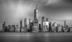 The City (B&W) (iShootPics) Tags: newyorkskyline glow clouds cityscape blackandwhite monochrome longexposure dramatic nj bw city sony hudsonriver a7r water light