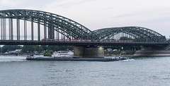 (l4ts) Tags: europe germany rhinevalley northrhinewestphalia riverrhine cologne hohenzollernbridge barge marina train
