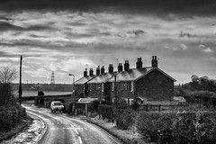 Moody Street (James- Burke) Tags: liverpool atmospheric blackwhite bw england fuji houses melling monochrome moody rural scenic street homes roads nostalgic skys clouds chimneypots