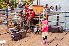 Little Concertgoer (Thad Zajdowicz) Tags: zajdowicz santamonica california availablelight outdoor outside canon eos 5d3 5dmarkiii dslr digital lightroom ef24105mmf4lisusm people child man concert music pier fun colour red pink color