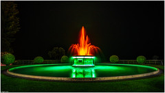 The 'Tom Parker' Fountain - II (nig gyl) Tags: x100t fujifilmx100t fujinon fujifilm fuji 23mm apsc fujixseries xtranssensor availablelight wideangle wideopen hawkesbay napier newzealand autumn northisland trippy sureal artdeco dinner sky tomparkerfountain fountain lurid topiary night nightlights tourist eyecatching drawcard