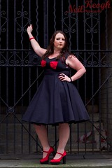 IMG_4517 (Neil Canon Keogh) Tags: red black vintage necklace highheels dress retro ring redhead bow buskers bracelet heels rockband pinup pinupgirl trianglesquare manchestercitycenter dressmodellaura