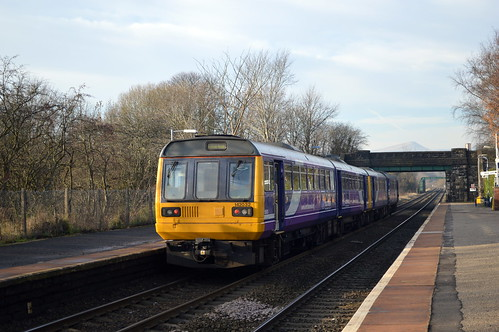 142032 on the rear of 142060 at Bamford with the 2S33 Sheffield to Manchester Piccadilly service, 11th Dec 2013.