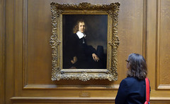 Beth examines Rembrandt van Rijn's A Young Man Seated at a Table (possibly Govaert Flinck) c. 1660