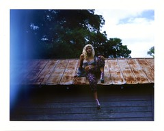 Lisette (mynameismaggielee) Tags: roof light color film college fashion swim polaroid outdoors model rust pretty natural florida large overcast suit blonde ambient instant fujifilm 4x5 sarasota jeffrey format campbell ringling portarit fp100