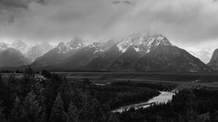 Black and White view of Grand Tetons (apdeshpande) Tags: grandteton tetons wyoming findyourpark grandtetons grandtetonnationalpark visitwyoming nps100 nationalpark nationalparks goparks snakeriver outdoors adventure travel blackandwhite bw highcontrast desaturated mountains snow river water trees bigmountains thankyounature handheld