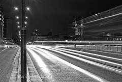 LondonBridge 038 E W BW (laurencemackman) Tags: lighting longexposure bridge england london cars architecture modern night reflections londonbridge concrete photography lights twilight traffic piers architect historical elevation riverthames span streamline londonskyline theshard motthayandanderson lordholford