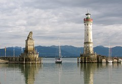 Lindau, Lake Constance, Germany (wonky knee) Tags: lighthouse alps germany deutschland boat harbour lionstatue bodensee tranquillity vorarlberg lakeconstance insellindau