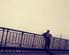 modeling for old navy? (Robert S. Photography) Tags: bridge man water sepia brooklyn pose oldnavy canonpowershot caesarsbay
