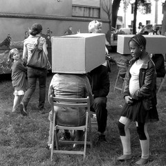 Spoofing a Private Conversation (Spotmatix) Tags: camera film monochrome festival effects iso100 belgium rangefinder places event fed brabantwallon polypanf ottignieslln