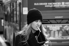 DSC09884 pretty girl smoking wearing a beanie (roger_thelwell) Tags: life street city uk winter portrait england people urban bw white black streets cold london monochrome beauty hat mobile hair walking real photography mono chat phone natural photos britain circus candid great hats cell photographic photographs oxford conversation talking speak speaking commuters