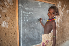 Student practices how to write on a black board (UNICEF Ethiopia) Tags: unicef education classroom ethiopia primaryschool omo omorate genderequality southomo girlseducation dasenech educationsocialdevelopment
