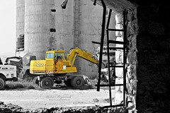 .. (Love me tender .**..*) Tags: blackandwhite abandoned monochrome yellow greek photography factory greece tractors hdr piraeus 2014 dimitra selectivecolors drapetsona kirgiannaki