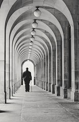 Sloping Off.  29/365. (FadeToBlackLP) Tags: monochrome blackandwhite arches manchester man hat silhouette town hall stonework architecture leading lines