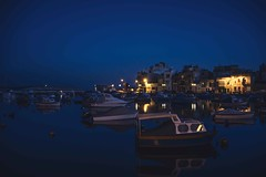 Blue hour by the port (Syahrel Azha Hashim) Tags: meditteranean nightshot reflection sony 2016 shallow holiday nopeople prettybay exterior vessels ocean mediterraneansea architecture boat ilce7m2 slowshutter 35mm building sonya7 dof handheld getaway port buildings colorimage vacation simple prime light bluesky naturallight dramaticsky bluehour a7ii boats birzebbuga syahrel details colorful malta clearsky jetty dock travel detail