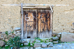 The Cat Flap (georgeplakides) Tags: kakopetria cyprus traditional doors frame catflap graffitti