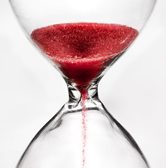 time trickles away... (marianna_a.) Tags: time timepiece hourglass red sand falling trickling grain funnel glass graphic mariannaarmata p1170113 f64 abstact motion macro f64g81champ