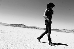 Roaming the Desert (jamiethissen-betts) Tags: freepeople boots stetson hat sketchykidssketchyshit boundbysin journeyman myphoto monochrome blackandwhite bnw melancholy cracked crack deathvalleynationalpark deathvalley desert gypsy boho woman girl