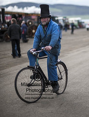 Man with Cool Hat on Bike - Errol Airfield  Tayside Scotland (Magdalen Green Photography) Tags: vintage scotland dundee scottish tayside steamrally 0674 vintagesteamrally stationaryengines precisionengineering steamvehicles iaingordon magdalengreenphotography errolairfield scottishtractionenginesociety manwithcoolhatonbike