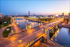Beautiful cityscape of Moscow (Dmitry Mordolff) Tags: street bridge blue sunset sky house motion blur reflection nature water skyline architecture night skyscraper buildings river outdoors lights town spring downtown cityscape waterfront view place russia dusk moscow district cities landmarks illuminated russian residential embankment scenics locations landscaped