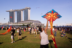 Singapore Kite Festival (Kokkai Ng) Tags: city travel blue people kite grass festival architecture marina asian fun toy bay flying singapore asia southeastasia day release crowd multicoloured happiness financialdistrict event entertainment cheerful enjoyment futuristic clearsky crowded headland promontory marinabay releasing urbanscene traditionalfestival placeofinterest largegroupofpeople asianethnicity marinabaysands singaporekitefestival publiccelebratoryevent marinabaysandshotel