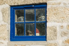 In Mousehole, Cornwall (chrisotruro) Tags: old blue sunlight dusty window glass cornwall granite cobwebs