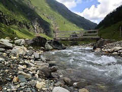 bridge (Anke L) Tags: bridge mountains alps water river austria stream stones rauris salzburgerland 2013 krumltal bräualm