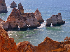 Algarve , the coastline near Alvor (STEHOUWER AND RECIO) Tags: ocean camera sea summer sun holiday portugal water stone composition photography climb photo high fishing fisherman rocks aqua view image tag tags coastline algarve uitzicht popular saltwater alvor rockformations steen rockformation mediterrenean rotsen kustlijn populartags vision:beach=073 vision:mountain=053