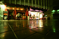 rat's eye view of sushi bar (pho-Tony) Tags: color colour green film contrast rollei 35mm lens 1 lomo lomography cross grain shift slide tint ishootfilm cast crossprocessing pro analogue 135 halfframe fullframe process ultrawide hue e6 malaga compact blend colorcast colourcast c41 17mm ultrawideangle superwide filmisnotdead photosofcameras cr200 digibase rolleicr200 rolleidigibasecr200pro lcwide lomolcw lomolcwide minigon17mm minigon
