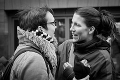 Reunion (Leanne Boulton) Tags: life street city winter girls friends portrait people urban blackandwhite bw woman white black cold reunion girl monochrome beautiful beauty smile weather smiling canon happy mono glasses scotland blackwhite clothing women warm pretty close emotion glasgow candid teeth happiness meeting scene human contact brunette closeness greeting interaction