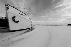 Frozen (barenstaden) Tags: winter sky bw snow cold ice boat frozen blackwhite helsinki ship angle stuck wind harbour pov wide anchor vision:sky=0865