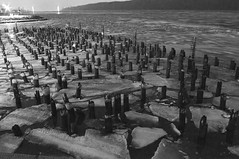 Dreary River (davegammon) Tags: ice river pier ruins hudson bnw fragments vision:outdoor=0865