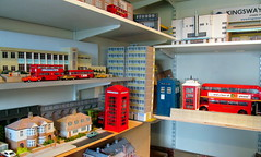 A glimpse inside the alternative reality factory........  [Explored] (kingsway john) Tags: kingsway models card kits shelves dioramas buses houses buildings flats scale cinema telphone kiosk boxes londontransportmodel model bus diorama 176 oo gauge explored miniature